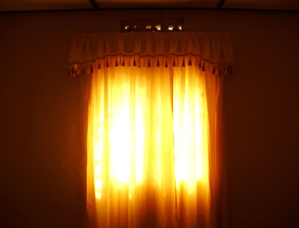 African Sun through curtains in Rwanda